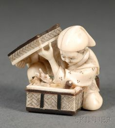 "Ivory Netsuke, Japan, 19th century,from a narrative ""Tongue-Cut Sparrow"" ,  figure of a man open a box and find treasure, signed to the underside, ht. 1 1/4 in."