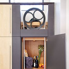 Dumb Waiter! On the dream bucket list. http://www.prefabhomeparts.com/residentialdumbwaiterlifts.php has some factors to take into consideration when choosing a dumbwaiter elevator for a residence.