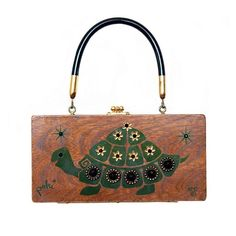 "Enid Collins of Texas 1968 ""Poki"" box bag. The title of this whimsical turtle design is a play on the word ""poky"" meaning slow. #findingENIDwithLOVE #enidcollinsoftexas #enidcollins #vintagestyle #vintagepurse #1968 #poki #turtle #turtleart"