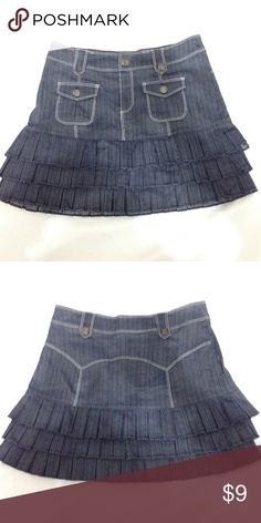 Skirt Cute Jean skirt with three layers of pleats, two front pockets & tabs for a belt perfect for any young fashionista. Worn three times. 55% Polyester, 42% Rayon, 3% Spandex Skirts