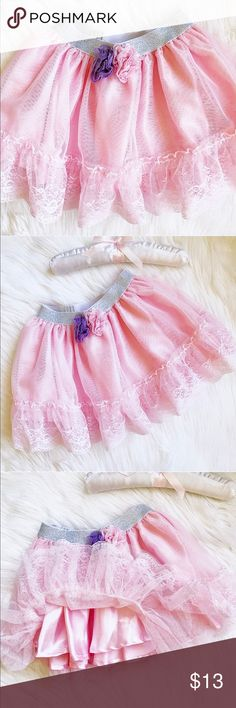 Toddler Girls Pink Tulle Skirt Your little one will feel like a princess in this adorable tulle skirt! Features an elasticized silver sparkle waistband,two from rosettes,and has layers of poly satin and tulle. In mint condition,my daughter only wore this once for two hours. Pairs great with the Birthday Girl tee also available in my closet! Size 3T💕 Koala Kids Bottoms Skirts