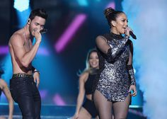 Jennifer Lopez Heats Up the Stage With 3 Hot Outfits and a Shirtless Prince Royce