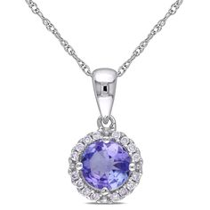 This amazing necklace from the Miadora Collection features a round-cut tanzanite stone surrounded by a halo of round white diamonds set in 10-karat white gold. This cheery pendant is hung on a rope chain and is secured with a spring ring clasp.