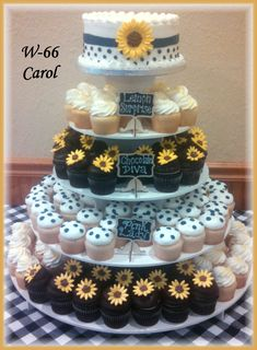 Navy blue and yellow with sunflowers give this cake and cupcakes their pop of color! By Rush City Bakery, Rush City, Mn.
