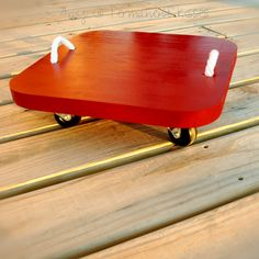 Scoot board... I remember riding these around at the gym