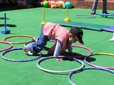 Ring Crawl Activity: (Focus: Eye hand and foot coordination) The client will utilize fine and gross motor components while crawling while placing hands and feet within the rings to complete the obstacle course. Activity Games For Kids, Gross Motor Activities, Team Building Activities, Gross Motor Skills, Therapy Activities, Physical Activities, Physical Education, Preschool Activities, Preschool Gymnastics