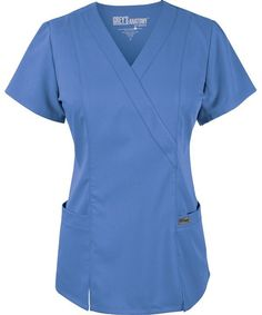 Grey's Anatomy 2 Pocket Mock Wrap Princess Scrub Top - Ciel Blue - Scrub Shopper  This junior fit mock wrap top has princess seams, front slits, and elastic back to aide in flexibility. Grey's Anatomy Woven Label on Back Pocket. Made of arcLuxfabric: 77% Polyester / 23% Rayon Twill featuring moisture wicking, soil resistance, and a soft hand.