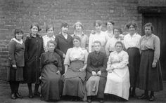 """""""This picture, also from about 1905, shows my Grandmother Nellie Holland (nee Onions) 2nd from the right on the back row of a group of fairly disconsolate looking female workers. The 1901 Census had her occupation as a dressmaker in Chester however there is no record for which employer she worked."""""""