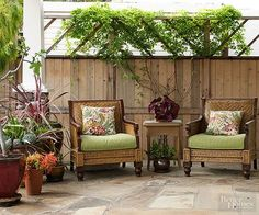 If you don't plan to use your patio for dining, forgo the table for a couple comfy chairs. A smaller side table offers a convenient spot to rest a beverage or a book. A variety of plantings along the perimeter help connect the patio to the rest of the yard.