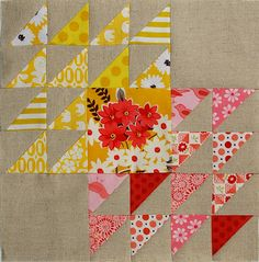 three plain blocks diagonally, with 24 half square triangle blocks.. colours used...by 'made during quiet time' blog