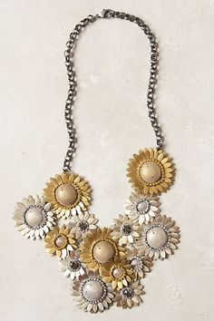 "Field Metal Necklace   DETAILS  Regardless of the weather, this bib of intricate, shimmered chrysanthemums will never wither.   Lobster clasp   Brass, glass, polyester, metallic thread, leather   13""L   6"" bib   Imported   $138"