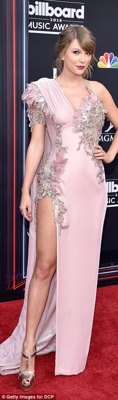 Red carpet queen:Taylor Swift jetted off to Las Vegas for the Billboard Music Awards at the MGM Grand Garden Arena on Sunday; she stunned in a pale pink and silver Atelier Versace gown