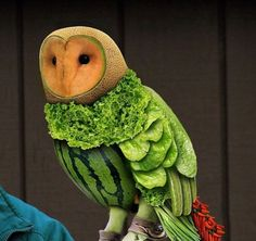 Owl made out of fruits and vegetables.