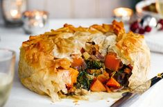 Butternut squash and Stilton filo pie An impressive pie packed with rich, hearty flavours – an excellent vegetarian Christmas main. Visit Tesco Real Food for more vegetarian Christmas recipes. Vegetarian Christmas Main, Veggie Christmas, Xmas Food, Vegan Christmas Dinner, Christmas Dinners, Holiday Dinner, Christmas Christmas, Veggie Dishes, Veggie Recipes