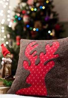 Brown wool and red flannel reindeer pillow. Visit & Like our Facebook page! https://www.facebook.com/pages/Rustic-Farmhouse-Decor/636679889706127