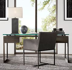 RH Modern's Latour Desk:A nod to the clean-lined aesthetic of 1970s French design. Constructed with open, angular drawer modules on either side, a glass desktop allows the rustic beauty of the bronze metal to take center stage.