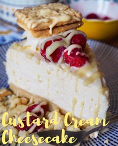 Custard Cream Cheesecake Slice drizzled in custard and topped with raspberries & a custard cream.png