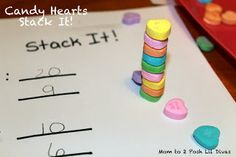 Stack It - how high can you go? Make a prediction & then stack to see if you can do it. Fun family or kids party game for Valentine's Day.