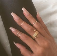 """If you're unfamiliar with nail trends and you hear the words """"coffin nails,"""" what comes to mind? It's not nails with coffins drawn on them. It's long nails with a square tip, and the look has. Nails Yellow, Nail Ring, Nail Nail, Nude Nails, Coffin Nails, Stiletto Nails, Neutral Acrylic Nails, Plain Acrylic Nails, Sparkly Acrylic Nails"""