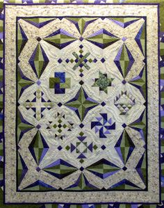 Simple blocks dressed up in beautiful quilting - by Sharon Schamber