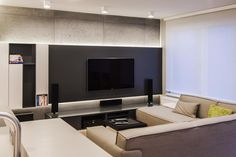 tv on the black wall