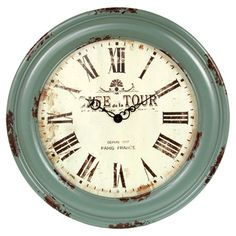 Weathered wood wall clock in mint green.   Product: Wall clockConstruction Material: WoodColor: M...