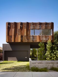 Wrapped in a folded Cor-ten steel curtain, the Walnut Residence's unforgettable exterior creates even more surprises indoors. Designed by Daniel Monti. Photo by: Benny Chan   Read more: http://www.dwell.com/articles/The-Giving-Tree.html