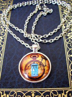 Steampunk Necklace (N152) - Silver Tray - TARDIS under Glass Cabochon Pendant with Chain - Doctor Who. $12.00, via Etsy.