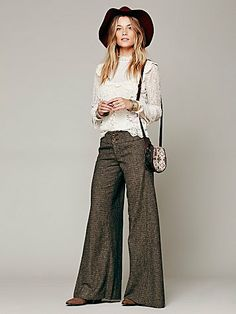 Free People Tweed Extreme Flare. flares are a great way to make the hips look smaller. Tweed styles like this one are flexible for office or day. Great with crop jackets or knit top with vest.