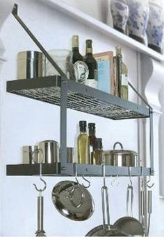 8516 - Rogar International Wall Mounted Pot Rack by Rogar International Corp.. $108.50. Amazing storage potential, double the storage w 2 shelves. Finish: Black/Brass. Includes 6 Eye and 2 Grid Hooks. Black w Chrome accessories. Can be used in kitchen, home office, laundry, garage, kid's room. etc. Finish Option:Black, Hook Finish Option:Brass Wall Mount Double Bookshelf   Amazing storage potential  Double the storage withtwo shelves  Can be used in kitchen, home ...