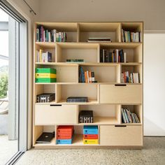 A great example of how to combine office storage and a bookshelf for the home office. Large soft close drawers hide away all the bits and provide ample storage Plywood Bookcase, Plywood Storage, Plywood Walls, Bookshelves, Bookshelf Storage, Bedroom Shelving, Plywood Cabinets, Modern Bookcase, Wall Shelves
