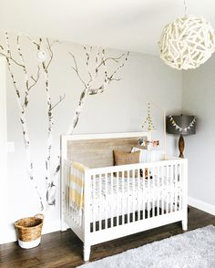 A neutral rustic chic woodland nursery with pops of aqua inspired by cool rustic hanging picture frames from HomeGoods.