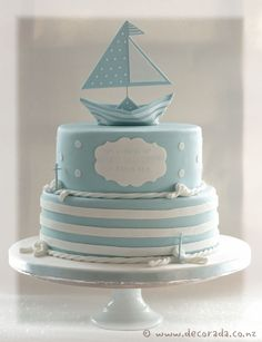 Two tier nautical themed christening cake, made to match the invitations which included a paper boat replicated in sugar work for the top of the cake.