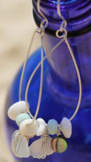 item #E024-S12 Mermaid's treasure hoops- are made with the most amazing selection of hand selected oahu pukas, abalone paua shell, oahu sea glass and amazonite all set on sterling silver hoops. (measuring 3 in by 1 in)