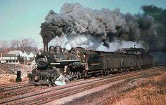 Delaware & Hudson Ten Wheeler 4-6-0 steam locomotive # 500, is seen hauling a local passenger train along the mainline at Carbondale, Pennsylvania, 11-09-1951