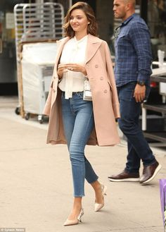 Pretty in pink: Miranda Kerr looked the epitome of elegance with a chic blush draped over her shoulders as she ran errands in Manhattan on Thursday