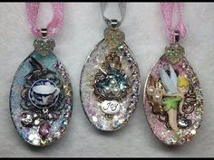DIY Sparkly Plastic Spoon Ornaments (using dollar store silver plastic spoons, glitter, and small trinkets and beads) - posted by OneVeryHappyBird on YouTube (41 min.)    ...could also be used as a necklace...