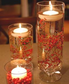 SO SIMPLE and elegant! Tall glasses, winter berries and floating candles... I'll have to remember this next Christmas!