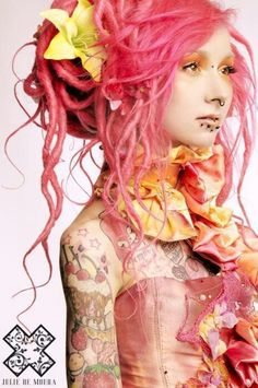 Pink dreads with big yellow flower