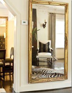 gilded full length mirror in hallway