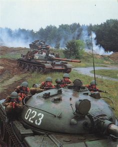 Soviet T-62 tanks and infantry.