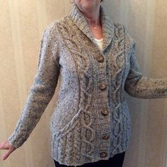 The Roosevelt Cardigan was inspired by menswear, but its subtle waist shaping and traveling cables, which emphasize an hourglass shape, lend a feminine touch. Deep front pockets are tucked under patterning for a seamless look.