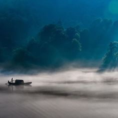 [ Top Shot from Sept. 24, 2014 ] Misty River | Photograph by Sammy Wong . A fisherman in Hunan, China. -- Top Shot features the photo with the most votes from the previous day's Daily Dozen, 12 photos chosen by the Your Shot editors from thousands of recent uploads. Our community votes for their favorite photo from the selection, and the Top Shot is showcased on the @natgeoyourshot Instagram feed. #YourShotPhotographer