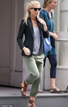 khaki trousers, a grey T-shirt and tan sandals