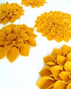 great tutorial for felted flowers - these would be great on a pillow.