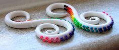 """Rainbow Tentacles Gauged Plugs. Sizes 2g, 0g, 00g ... extra cost for sizes 7/16"""", 1/2"""", 9/16"""", 5/8"""". $25.00, via Etsy."""