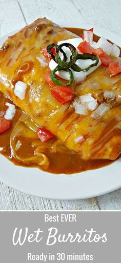 Best ever Smothered Wet Burritos Recipe - These beef and bean wet burritos are smothered with red sauce and melted cheese. Top with your favorites such as guacamole, sour cream, lettuce, onion, and tomatoes. Ready in just 30 minutes.