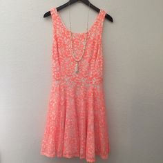 Guess Neon Lace Cut-out Dress This dress is so perfect for spring and summer! White dress with a orange coral neon lace overlay. Back has a diamond shape cutout that zips. Super fun, punchy and can be dressed up or down. Worn twice. Guess Dresses