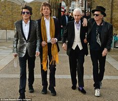 The Rolling Stones (left to right): Ronnie Wood, Mick Jagger, Charlie Watts and…