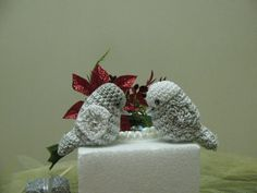 white and silver crochet love birds cake topper. $27.00, via Etsy.